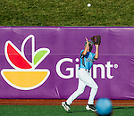 August 14, 2014: West Raleigh(NC)'s Koen Moreno (5) brings in a deep fly ball against Hanford(CA) during the Cal Ripken 12u 70-foot World Series United States Semifinals at the Ripken Experience powered by Under Armour in Aberdeen, Maryland on August 14, 2014. Scott Serio/Ripken Baseball/CSM