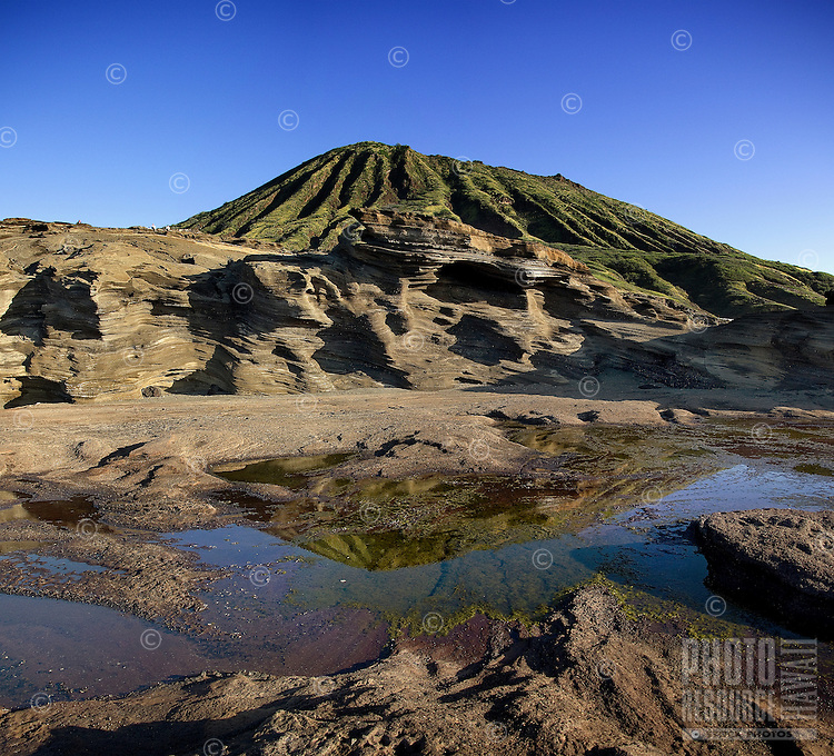 Beautiful view of Koko Crater reflecting in a tide pool fromLana'i Lookout, O'ahu