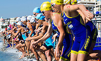 16 SEP 2012 - NICE, FRA - Competitors run into the water at the start of the final stage of the women's French Grand Prix triathlon series held during the Triathlon de Nice Côte d'Azur .(PHOTO (C) 2012 NIGEL FARROW)