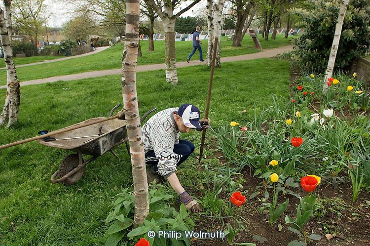 Gardener Joe Ambrosino working at Meanwhile Gardens, a community-run open space in North Kensington, London.