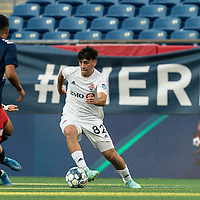 FOXBOROUGH, MA - JULY 23: Julian Altobelli #82 of Toronto FC II dribbles during a game between Toronto FC II and New England Revolution II at Gillette Stadium on July 23, 2021 in Foxborough, Massachusetts.