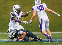 8 October 2016: Amherst College Purple & White Defensive Lineman Niyi Odewade, a Senior from Newark, NJ, celebrates a tackle of  Middlebury College Panther Running Back Drew Jacobs, a Junior from Marblehead, MA, at Alumni Stadium in Middlebury, Vermont. The Panthers edged out the Purple & While 27-26. Mandatory Credit: Ed Wolfstein Photo *** RAW (NEF) Image File Available ***