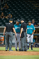 AZL Mariners manager Yoel Monzon (17) exchanges words with umpires Andrew Clark and Raymond Patchen during the game against the AZL Cubs on August 4, 2017 at Sloan Park in Mesa, Arizona. AZL Cubs defeated the AZL Mariners 5-3. (Zachary Lucy/Four Seam Images)