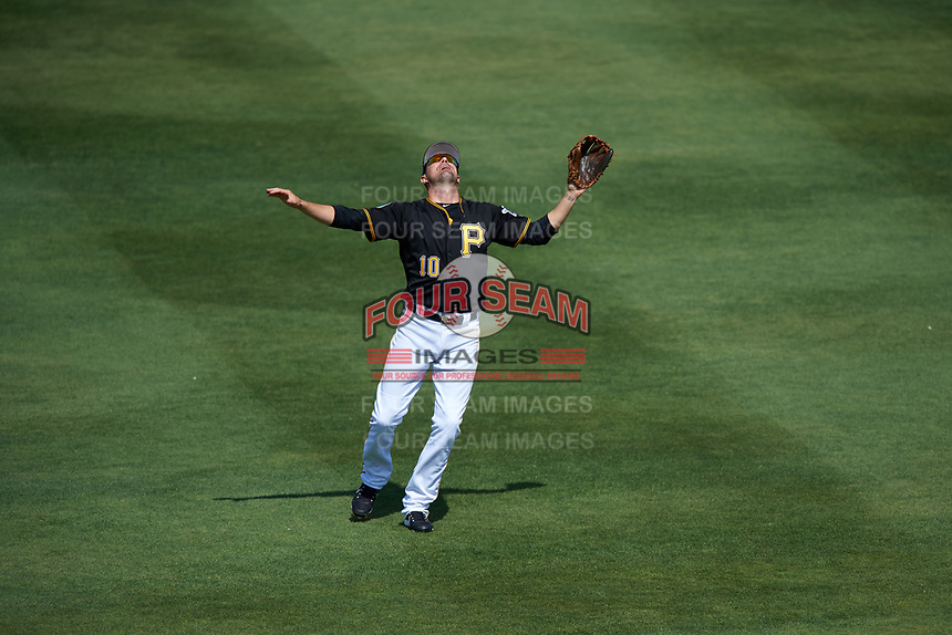 Pittsburgh Pirates shortstop Jordy Mercer (10) settles under a fly ball during a Spring Training game against the Tampa Bay Rays on March 10, 2017 at LECOM Park in Bradenton, Florida.  Pittsburgh defeated New York 4-1.  (Mike Janes/Four Seam Images)