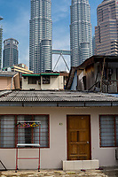 Kampung Baru, Middle-class Family House in Traditional Malay Enclave, Petronas Towers in background. Kuala Lumpur, Malaysia.