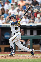 Michigan Wolverines third baseman Blake Nelson (10) follows through on his swing during Game 11 of the NCAA College World Series against the Texas Tech Red Raiders on June 21, 2019 at TD Ameritrade Park in Omaha, Nebraska. Michigan defeated Texas Tech 15-3 and is headed to the CWS Finals. (Andrew Woolley/Four Seam Images)