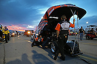 Apr. 5, 2013; Las Vegas, NV, USA: The sun sets behind NHRA funny car driver Johnny Gray in the staging lanes during qualifying for the Summitracing.com Nationals at the Strip at Las Vegas Motor Speedway. Mandatory Credit: Mark J. Rebilas-