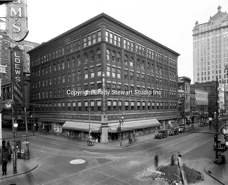 Pittsburgh PA:  View of the FW Woolworth Building at the corner of Liberty Avenue and Sixth Street.  Clark Building in the background and the popular Loew's Theatre on Sixth Street.  Heinz Hall is currently located in the same location on Sixth Street and Penn Avenue.