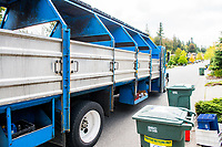 A Sanitary Service Company truck picks up recyclable goods in the Whatcom Falls neighborhood of Bellingham. Photo by Daniel Berman