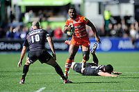 Vereniki Goneva of Leicester Tigers escapes past an outstretched Alistair Hargreaves of Saracens as Charlie Hodgson of Saracens blocks his path during the Aviva Premiership Rugby match between Saracens and Leicester Tigers at Allianz Park on Saturday 11th April 2015 (Photo by Rob Munro)