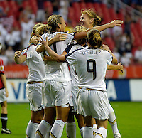 The U.S. celebrates Abby Wambach's first goal. The United States (USA) defeated Norway (NOR) 4-1 during the third place match of the Women's World Cup China 2007 at Shanghai Hongkou Football Stadium in Shanghai, China, on September 30, 2007.
