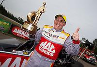 Mar 16, 2014; Gainesville, FL, USA; NHRA top fuel dragster driver Doug Kalitta celebrates after winning the Gatornationals at Gainesville Raceway Mandatory Credit: Mark J. Rebilas-USA TODAY Sports