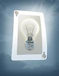 Illustrative image of lit bulb on trump card representing jackpot