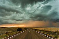 Colorful thunderstorm at sunset on a highway near Vaughn, NM, May 23, 2014
