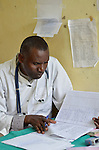 A physician working on files in the maternity ward in Nayagatare Hospital, Rwanda....