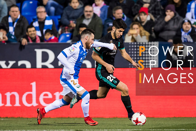 Marco Asensio Willemsen (R) of Real Madrid battles for the ball with Roberto Roman Triguero of CD Leganes during the Copa del Rey 2017-18 match between CD Leganes and Real Madrid at Estadio Municipal Butarque on 18 January 2018 in Leganes, Spain. Photo by Diego Gonzalez / Power Sport Images