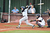 Pulaski Yankees second baseman Jesus Bastidas (12) swings at a pitch during game one of the Appalachian League Championship Series against the Elizabethton Twins at Joe O'Brien Field on September 7, 2017 in Elizabethton, Tennessee. The Twins defeated the Yankees 12-1. (Tony Farlow/Four Seam Images)