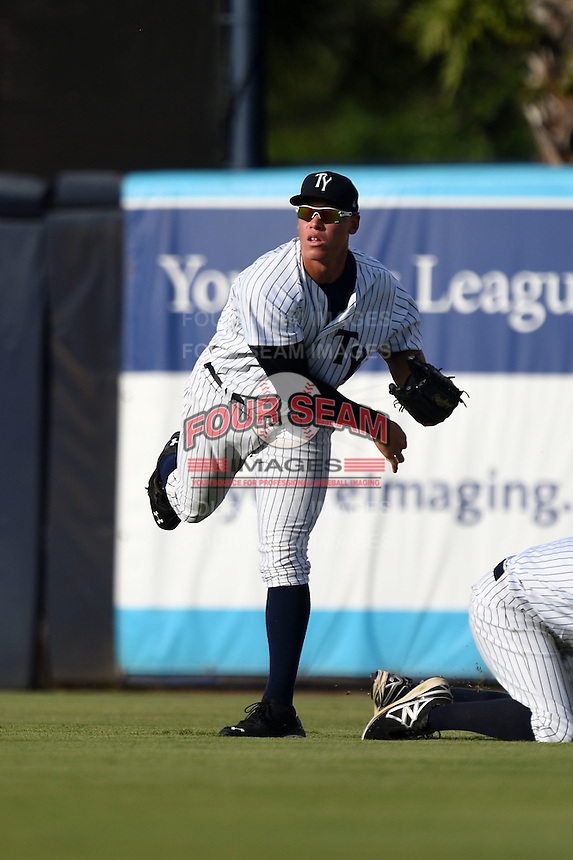 Tampa Yankees outfielder Aaron Judge (59) throws the ball in during a game against the Dunedin Blue Jays on June 28, 2014 at George M. Steinbrenner Field in Tampa, Florida.  Tampa defeated Dunedin 5-2.  (Mike Janes/Four Seam Images)