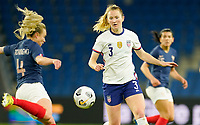 LE HAVRE, FRANCE - APRIL 13: Samantha Mewis #3 of the United States defending during a game between France and USWNT at Stade Oceane on April 13, 2021 in Le Havre, France.