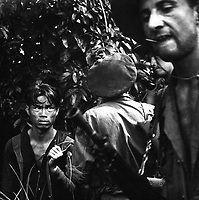 The French Foreign Legion is playing the major combat role in the war against the Vietminh.  Here a red-suspect has been found hiding in the jungle and is now being questioned by the advance patrol, who caught him.  Ca.  1954.  Pix.  (USIA)<br /> EXACT DATE SHOT UNKNOWN<br /> NARA FILE #:  306-PS-55-10516<br /> WAR & CONFLICT BOOK #:  383