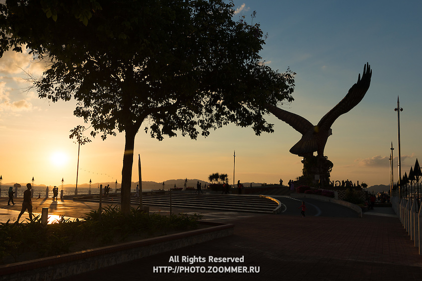 Silhouette of eagle statue on eagle square at sunset, Langkawi, Malaysia