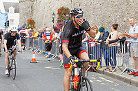Pictured: Gareth Thomas sends kisses to fans during the last mile of the cycle race. Sunday 15 September 2019<br /> Re: Ironman triathlon event in Tenby, Wales, UK.