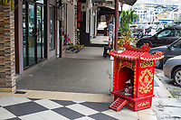 Sidewalk Shrine Opposite Entrance to Store, Ipoh, Malaysia.