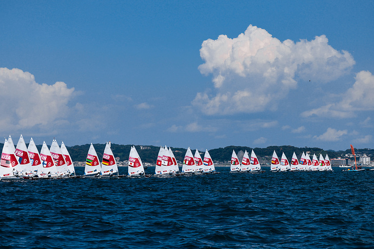 There's just a glimpse of Annalise Murphy's second-row start to leeward of Peru (13 boats from right) in the first race of the Laser Radials in the Tokyo Olympic competition. The Irish Rio silver medalist started mid line and recorded a 35th in the first race of her 44-boat fleet, the biggest fleet of the Olympic regatta. Photo: Sailing Energy