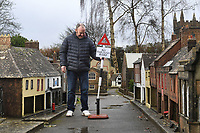 BNPS.co.uk (01202 558833)<br /> Pic: ZacharyCulpin/BNPS<br /> <br /> Pictured: Manager Nick Clark with the signs<br /> <br /> A popular model village has installed 1950s style road signs in a bid to ensure social distancing.<br /> <br /> Wimborne Model Town in Dorset is due to open back up to the public at the end of March and was desperate to adhere to government guidelines.