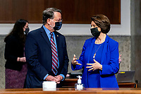 United States Senator Gary Peters (Democrat of Michigan), Chairman, US Senate Committee on Homeland Security and Government Affairs., left, and US Senator Amy Klobuchar (Democrat of Minnesota), Chairman, US Senate Committee on Rules and Administration, right, speak before the start of a Senate Homeland Security and Governmental Affairs & Senate Rules and Administration joint hearing on Capitol Hill, Washington, Tuesday, Feb. 23, 2021, to examine the January 6th attack on the Capitol. <br /> Credit: Andrew Harnik / Pool via CNP /MediaPunch