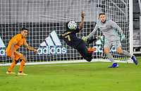 CARSON, CA - OCTOBER 28: Latif Blessing #7 of LAFC flying for a ball during a game between Houston Dynamo and Los Angeles FC at Banc of California Stadium on October 28, 2020 in Carson, California.