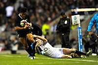Julian Savea of New Zealand is tackled by Chris Ashton of England during the QBE Autumn International match between England and New Zealand at Twickenham on Saturday 16th November 2013 (Photo by Rob Munro)