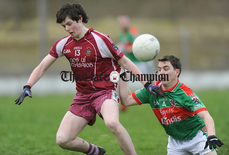 Conor Finucane of Lissycasey in action against Martin Mc Mahon of Kilmurry Ibrickane during their Cusack Cup game at Lissycasey. Photograph by John Kelly.