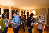 """SEATTLE, WA-APRIL 17, 2017:  Charissa Pomrehn, left, speaks with Nason Fox, Stefanie Fox speaks with Patricia Rangel, and Anjana Agarwal speaks with Amanda Saab, far right, as the dinner party guest prepare to leave. Amanda Saab, along with her husband Hussein Saab, co-hosted a """"dinner with your Muslim neighbor"""" at the home of Stefanie and Nason (cq) Fox in Seattle, WA on a return trip April 17th 2017. The couple now live in Detroit. <br /> <br /> (Photo by Meryl Schenker/For The Washington Post)"""