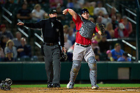 Worcester Red Sox catcher Chris Herrmann (18) throws to first base to complete the strikeout as umpire Louie Krupa looks on during a game against the Rochester Red Wings on September 3, 2021 at Frontier Field in Rochester, New York.  (Mike Janes/Four Seam Images)