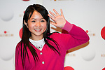 """Dec. 29, 2009 - Enka singer, Maya Sakura, poses for photographers during the first day of rehearsals for 'Kohaku Uta Gassen,' or also more commonly known as 'Kohaku.' Produced by the Japanese public broadcaster, NHK, this annual music show airs on New Year's Eve and ends shortly before midnight, where everyone on air pauses to say """"Happy New Year."""" The 'Red and White Song Battle' separates the most popular music artists during each given year into teams of red and white: the red team consists of all female artists and the white team is all male artists. For an artist to perform on Kohaku, it is a great honor as only the most successful enka singers and J-Pop artist are strictly invited to perform by invitation only. Today, for a J-Pop artist or enka singer to perform on Kohaku, is most notably recognized to be a big highlight in a singer's career due to the show's large reach of audience during New Year's Eve."""