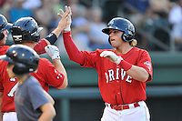 Left fielder Trenton Kemp (17) of the Greenville Drive is congratulated after hitting a home run in a game against the Greensboro Grasshoppers on Thursday, July 14, 2016, at Fluor Field at the West End in Greenville, South Carolina. Greenville won, 3-1. (Tom Priddy/Four Seam Images)
