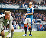 Martyn Waghorn watches as Queens keeper Robbie Thomson saves his penalty kick