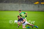 Knocknagoshels Michael Walsh takes a hefty tackle from Marc Ó Mainin of Lispole in the County Football league division 4 relegation game.