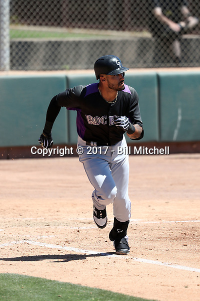 Ian Desmond plays for the Colorado Rockies in an extended spring training game against the Arizona Diamondbacks at Salt River Fields on April 29, 2017 in Scottsdale, Arizona. Desmond was rehabbing an injury suffered in spring training when an errant pitch broke his hand (Bill Mitchell)