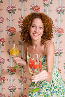 Redheaded woman wearing floral in front of pink floral wallpaper<br />