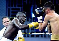 BARRANQUIILLA - COLOMBIA, 24-02-2018: El equipo los Heróicos de Colombia, derrotó 3-2 a los Caciques de Venezuela y obtuvo la primera victoria en la Serie Mundial de Boxeo en el 2018, la velada celebrada en el coliseo de Combarranquilla de la Calle 30 en el municipio de Soledad.En la foto Yuberjen Martínez (COL)y Luis Polanco (VEN) / The Heroicos de Colombia team, defeated the Caciques de Venezuela 3-2 and won the first World Boxing Series victory in 2018, the evening held at the Combarranquilla Coliseum on Calle 30 in the municipality of Soledad. the photo Yuberjen Martínez (COL) and Luis Polanco (VEN).  Photo:VizzorImage / Alfonso Cervantes / Contribuidor