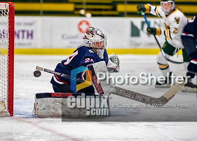 9 February 2020: University of Connecticut Husky Goaltender Morgan Fisher, a Senior from Vernon, CT, deflects a shot wide in second period action against the University of Vermont Catamounts at Gutterson Fieldhouse in Burlington, Vermont. The Lady Cats defeated the Huskies 6-2 in the second game of their weekend Hockey East series. Mandatory Credit: Ed Wolfstein Photo *** RAW (NEF) Image File Available ***