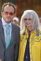 Elvis Costello and Emmylou Harris<br /> PERFORMING AT THE NBC CONCERT SERIES, ROCKEFELLER CENTER, <br /> NEW YORK CITY 07-22-2005<br /> Photo By John Barrett/PHOTOlink.net