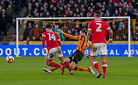 Hull City's midfielder Jackson Irvine (4) takles Nottingham Forest's midfielder Matty Cash (14) during the FA Cup 4th round match between Hull City and Nottingham Forest at the KC Stadium, Kingston upon Hull, England on 27 January 2018. Photo by Stephen Buckley / PRiME Media Images.