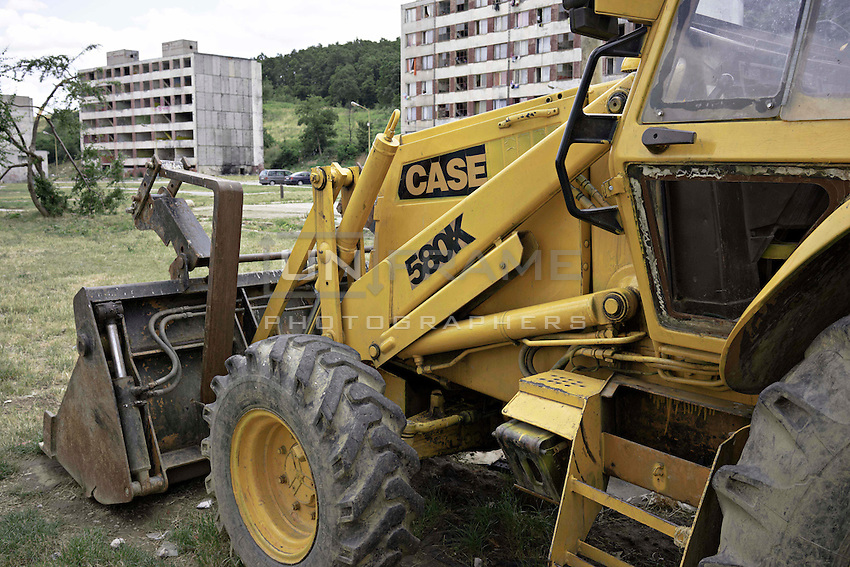 A digger on standby once one of Lunik IX blocks has been demolished.