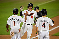 Bowie Baysox catcher Martin Cervenka (13) is congratulated by Ademar Rifaela (1) and Ryan Mountcastle (4) as he crosses home plate after hitting a home run in the bottom of the fifth inning during the second game of a doubleheader against the Trenton Thunder on June 13, 2018 at Prince George's Stadium in Bowie, Maryland.  Bowie defeated Trenton 10-1.  (Mike Janes/Four Seam Images)