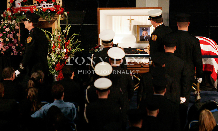 FUNERAL for Ann Arbor firefighter Amy Schnearle-Pennywitt on Tuesday, January 17, 2006 in Ann Arbor, MI. Schnearle-Pennywitt was the first women firefighter to die in the line of duty in Washtenaw County. TONY DING/Special to the Free Press