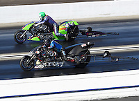 Feb 12, 2017; Pomona, CA, USA; NHRA top fuel nitro Harley rider Jay Turner (near) races alongside Andy Beauchemin during the Winternationals at Auto Club Raceway at Pomona. Mandatory Credit: Mark J. Rebilas-USA TODAY Sports