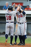 Garrison Schwartz (18) of the Danville Braves is met at home plate by teammates Jeffrey Ramos (13) and Derian Cruz (7) after having hit a 3-run home run against the Burlington Royals at Burlington Athletic Stadium on August 12, 2017 in Burlington, North Carolina.  The Braves defeated the Royals 5-3.  (Brian Westerholt/Four Seam Images)